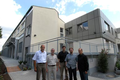 Wolfgang & Stefan Kaiser with production managers in front of extension at the Friedr Freek Factory, Menden, Germany.